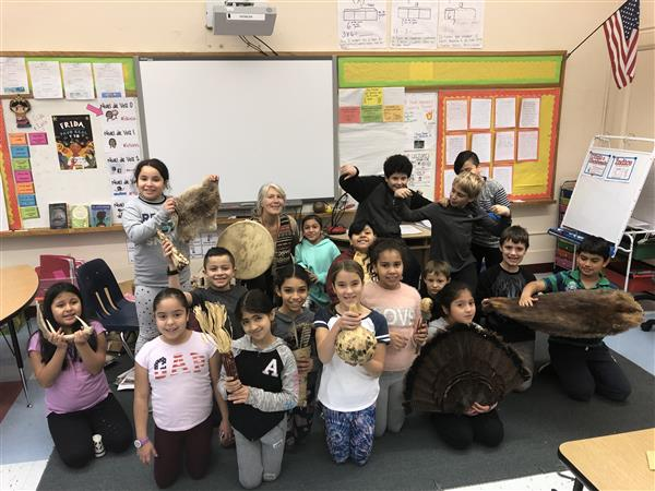 4th grade students displaying antlers, fur and other things used in Native American culture.