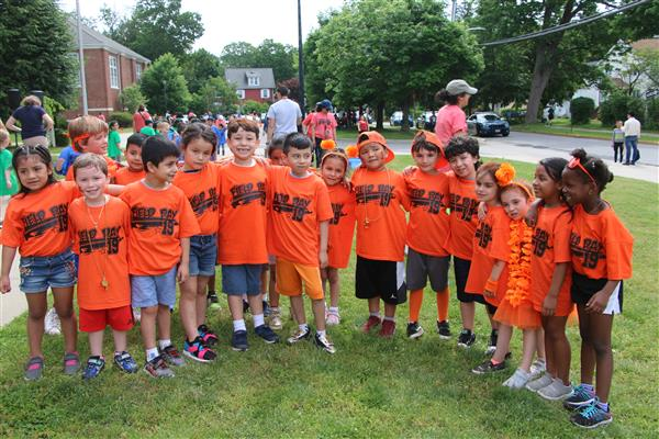 Children posing together in their field day t shirts.