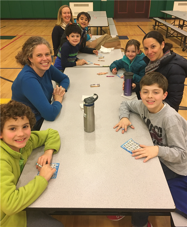 MKES students and parents playing Bingo