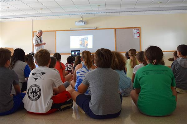 Students listen to bus safety presentation
