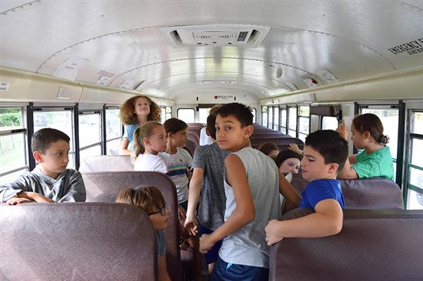 Students prepare for bus safety evacuation drill