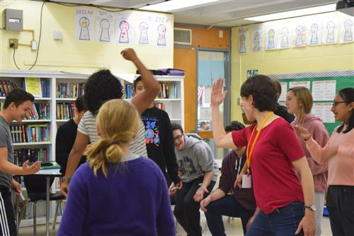 FLMS students laugh while doing a Shakespeare exercise