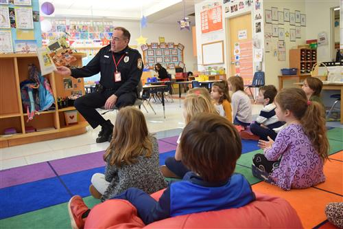 PRES Read Aloud Day - Detective Mulcahy reading to kindergarteners