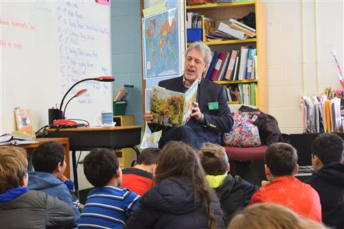 PRES Read Aloud Day - Kevin Hansan reading to students