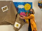 Sarah Gilchrist pulls paper covering to reveal colorful mural