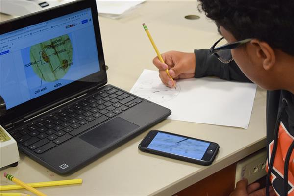 student uses 1:1 technology in Environmental Science